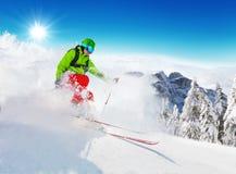 Freeride skier on piste running downhill Royalty Free Stock Photos