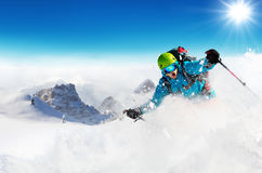 Freeride skier on piste running downhill Royalty Free Stock Images