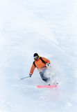 Freeride skier in powder snow. Young male freeride skier making a turn in powder snow Royalty Free Stock Image