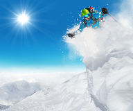 Freeride skier ready to jump. In freeze motion of snow powder Stock Photography
