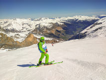 Freeride Skier With Rucksack Running Downhill. In Freeze Motion On The Slope In HinterTux, Austria Stock Photo