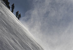 Freeride Skiing. Ferried skiers stand on the top of a mountain in powder snow on a sunny day in western Austria Stock Photos