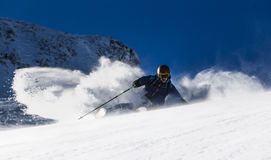 Freeride Skiing. A Skier makes a turn in powder snow Royalty Free Stock Photography