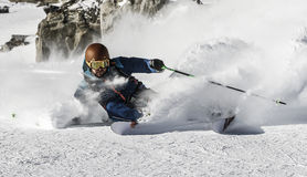 Freeride Skiing. A Skier makes a turn in powder snow Stock Image