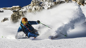 Freeride Skiing. A Skier makes a turn in powder snow Royalty Free Stock Image
