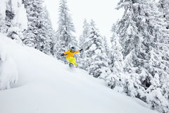 Freeride snowboarder on ski slope Stock Photo