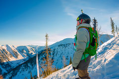 Freeride snowboarder stands on hillside in light dawn sun Stock Photography