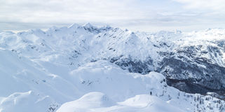 Freeride snowboarder on the top of the mountain. Royalty Free Stock Images