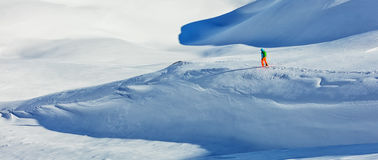 Freerider alpine skier walking in fresh snow. Freerider alpine skier walking in fresh powder snow. Wide composition Stock Photography