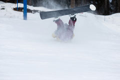 Freerider falling down the slope. Male snowboarder falls on the slopes during the descent Stock Photography