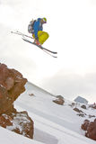Freerider jumping in a mountains. Freeride in Caucasus mountains, winter Royalty Free Stock Photography