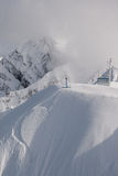 Freerider preparing to descend from the summit. Ridge Aibka, Sochi, Russia Royalty Free Stock Images