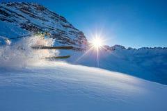 Freerider skier jumping in fresh powder snow. In beautiful Alpine landscape. Fresh powder snow, blue sky on background Royalty Free Stock Photo