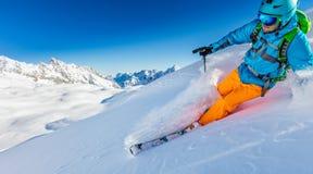 Freerider skier running downhill. In beautiful Alpine landscape. Fresh powder snow, blue sky on background Royalty Free Stock Photos