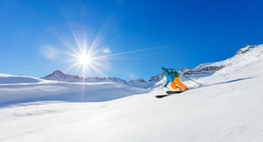 Freerider skier running downhill Stock Image