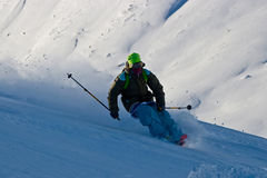 Freerider and snow powder. Freerider in the aura of snow powder Stock Image