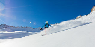 Freerider snowboarder running downhill Royalty Free Stock Image