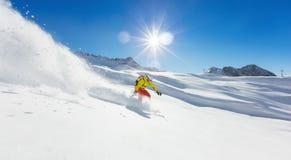 Freerider snowboarder running downhill Royalty Free Stock Photos