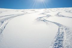 Freeriding on fresh snowy slope Royalty Free Stock Photography