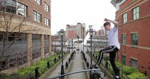 Freerunner balancing on a bridge. Freerunner is balancing his way across a bridge on the quayside in Newcastle city stock footage
