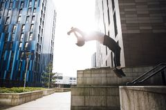 Freerunner doing a Backflip in the City Royalty Free Stock Photo