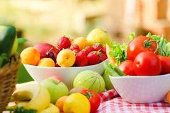 Freesh organic fruits and vegetables. Fruits and vegetables on a table stock photo