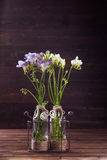 Freesia bouquet. Easter flower bouquet with freesia on wooden background with copyspace stock image