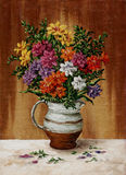 Freesia in a milk jug. Picture oil paints on a canvas: a bouquet of freesia in a milk jug Stock Image