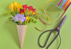 Freesias flowers in ice cream waffles Stock Image