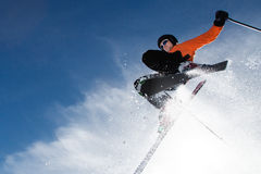 Freeskier in a jump. Freeskier in a high jump with a lot of powder Stock Photos