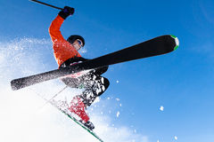 Freeskier in a jump. Freeskier in a high jump with a lot of powder Royalty Free Stock Photos