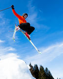 Freeskier in a jump. Freeskier in a high jump with a lot of powder Royalty Free Stock Images