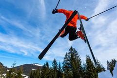 Freeskier in a jump. Freeskier in a high jump with a lot of powder Stock Photo