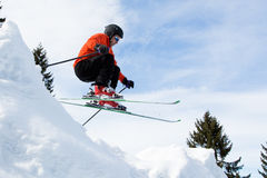 Freeskier in a jump. Freeskier in a high jump with a lot of powder Stock Photography