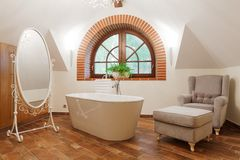 Freestanding bath in designed restroom Stock Image