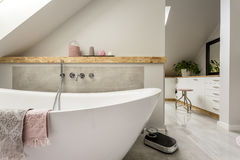 Freestanding bath in grey bathroom Royalty Free Stock Photo