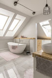 Freestanding bath in marble bathroom stock photography