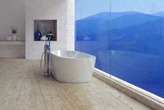 Freestanding bathtub with a mountain view Stock Image
