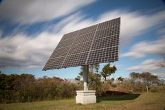 Freestanding solar panel. On a bright autumn day with blue skies and puffy clouds royalty free stock photos