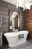 Freestanding vintage style bath tub in renovated warehouse apart Royalty Free Stock Photography