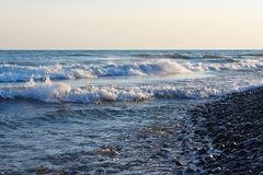 Freestream waves on the beach in evening Royalty Free Stock Photo