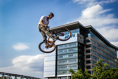 Freestyle Biker Performing a Stunt in Mid-Air Royalty Free Stock Photo