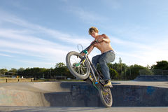 Freestyle BMX rider doing a trick Royalty Free Stock Photo