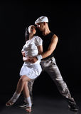 Freestyle dance. Freestyle dancing couple on black Royalty Free Stock Photos