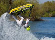 Freestyle Jet Skier performing back flip creating at lot of spray. WYBOSTON, BEDFORDSHIRE, ENGLAND - APRIL 09, 2017: Freestyle Jet Skier performing back flip Stock Photo