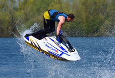 Freestyle Jet Skier performing 360 creating at lot of spray. WYBOSTON, BEDFORDSHIRE, ENGLAND - APRIL 21, 2018: Freestyle Jet Skier performing 360 creating at lot Stock Photos
