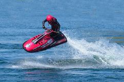 Freestyle Jet Skier performing 360  creating at lot of spray. Stock Image
