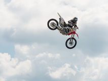 Freestyle Jumper. A freestyle rider doing a dangerous stunt at the Triumph Superbike Races in Birmingham, Alabama at Barber Motorsports Park on June 21, 2014 Royalty Free Stock Photography