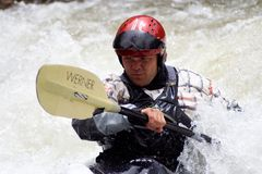 Freestyle Kayaker. A man paddles into Vail's Whitewater Park to practice his freestyle run at the 2010 Teva Mountain Games, held in Vail, CO Royalty Free Stock Photography