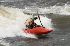 Freestyle Kayaker. A freestyle kayaker navigates through river rapids in Steamboat Springs, Colorado Royalty Free Stock Photos